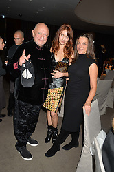 Left to right, STEVEN BERKOFF, OLGA KURYLENKO and BARBARA BROCCOLI at a dinner hosted by Liberatum to honour Francis Ford Coppola held at the Bulgari Hotel & Residences, 171 Knightsbridge, London on 17th November 2014.