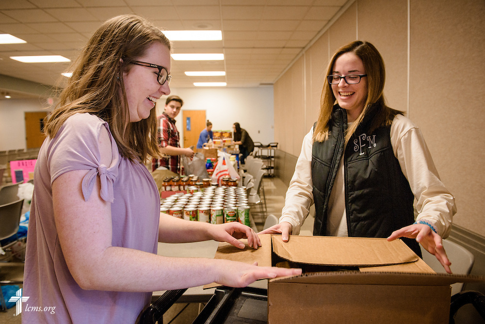 Isabella Schneider (left) and Sarah Franklin pack food pantry items for delivery on Sunday, Feb. 26, 2017, at Immanuel Lutheran Church & School in St. Charles, Mo. LCMS Communications/Erik M. Lunsford