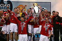 Ryan Giggs and team mate Gary Neville and Rest of the United team Celebrate with Premier League Trophy<br />