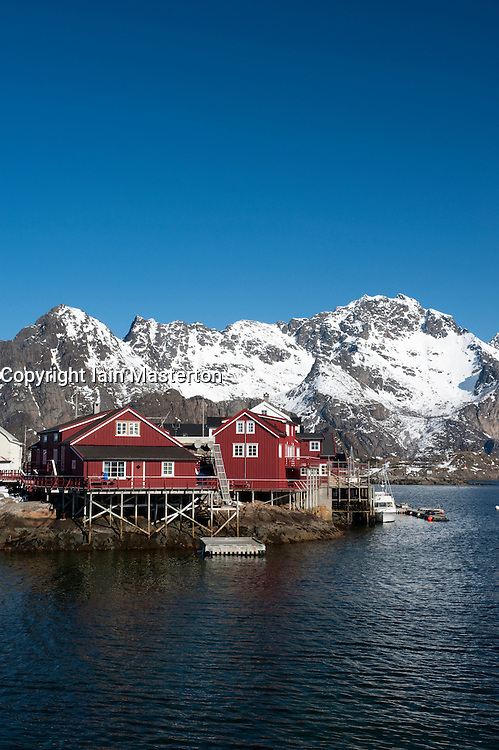 Traditional red wooden Rorbu fishermens` huts in village of Henningsvaer in Lofoten Islands in Norway