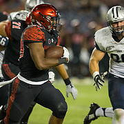 03 September 2016: The San Diego State Aztecs football team open's up the season at home against the University of New Hampshire Wildcats. San Diego State running back Rashaad Penny (20) rushes the ball in the second half of the game. The Aztecs beat the Wildcats 31-0. www.sdsuaztecphotos.com