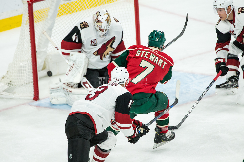 Dec 17, 2016; Saint Paul, MN, USA; Minnesota Wild forward Chris Stewart (7) scores a goal during the third period against the Minnesota Wild at Xcel Energy Center. The Wild defeated the Coyotes 4-1. Mandatory Credit: Brace Hemmelgarn-USA TODAY Sports