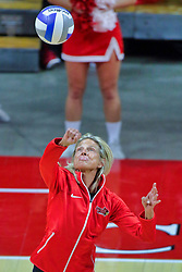 BLOOMINGTON, IL - October 12: Julie Morgan makes the honorary first serve during a college Women's volleyball match between the ISU Redbirds and the Valparaiso Crusaders on October 12 2018 at Illinois State University in Bloomington, IL.   Julie is a 2018 inductee to the Percy Family Hall of Fame and he winningest women's volleyball coach in ISU's history. (Photo by Alan Look)