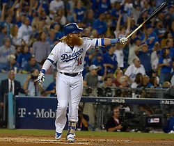 October 6, 2017 - Los Angeles, California, U.S. - Los Angeles Dodgers' Justin Turner watches his three run home run against the Arizona Diamondbacks in the first inning of a National League Divisional Series baseball game at Dodger Stadium on Friday, Oct. 06, 2017 in Los Angeles. (Photo by Keith Birmingham, Pasadena Star-News/SCNG) (Credit Image: © San Gabriel Valley Tribune via ZUMA Wire)