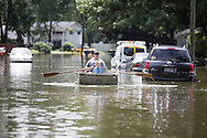 8/17/2016: Aaron Nowak rows a boat down Danbury Drive in South Bend on Tuesday. Tribune Photo/SANTIAGO FLORES<br /> <br /> Torrential rains flooded parts of South Bend and closed many streets on Tuesday August 16, 2016. The Crest Manor neighborhood on the south end of town was particularly hard hit.  Many home sustained water damage.  Aaron Nowak rows a boat down Danbury Dr. Tribune Photo/SANTIAGO FLORES