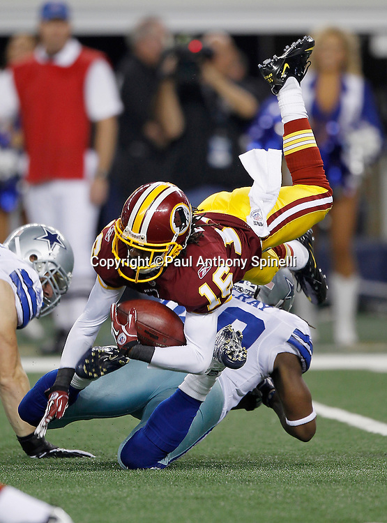 Washington Redskins wide receiver Brandon Banks (16) gets upended by Dallas Cowboys defensive back Danny McCray (40) while returning a fourth quarter kick during the NFL week 3 football game against the Dallas Cowboys on Monday, September 26, 2011 in Arlington, Texas. The Cowboys won the game 18-16. ©Paul Anthony Spinelli