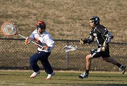 Virginia Cavaliers G Adam Ghitelman (8) in action against Bryant. The #1 ranked Virginia Cavaliers faced the Bryant Bulldogs at the University of Virginia's Klockner Stadium in Charlottesville, VA on February 16, 2009.