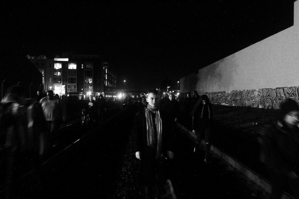 Protestors walking down the train track in Berkeley, CA headed towards Downtown Oakland. 2014