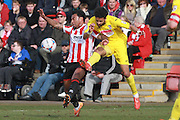 Jordan Cranston and Bruno Andrade during the Vanarama National League match between Cheltenham Town and Woking at Whaddon Road, Cheltenham, England on 12 March 2016. Photo by Antony Thompson.