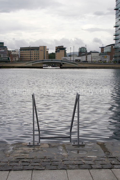 Ladder down to the water on Grand Canal Square in Dublin's docklands, Ireland