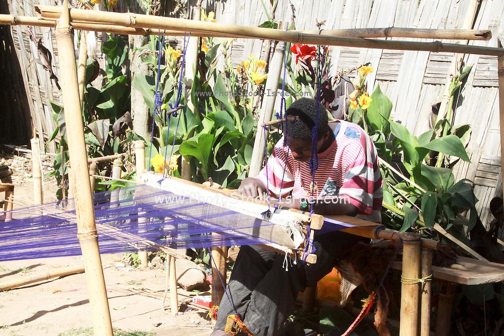 Africa, Ethiopia, Omo region, Chencha village, Dorze tribe man weaves at a hand loom