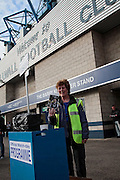Programme seller outside the Den before the Sky Bet League 1 play-off second leg match between Millwall and Bradford City at The Den, London, England on 20 May 2016. Photo by Nigel Cole.