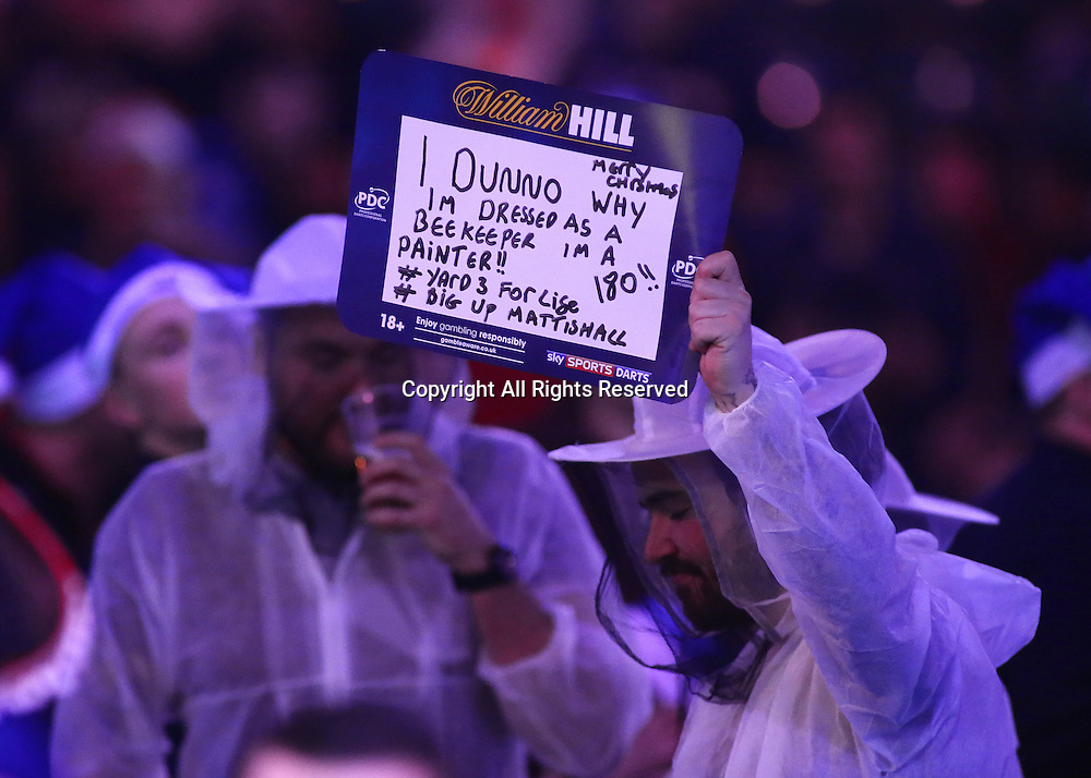 23.12.2016. Alexandra Palace, London, England. William Hill PDC World Darts Championship. A fan dressed as a beekeeper holds up his banner
