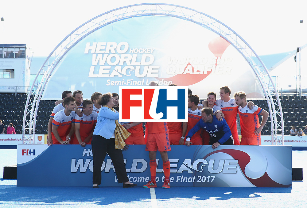 LONDON, ENGLAND - JUNE 25: Billy Bakker of the Netherlands receives the trophy during the final match between Argentina and the Netherlands on day nine of the Hero Hockey World League Semi-Final at Lee Valley Hockey and Tennis Centre on June 25, 2017 in London, England. (Photo by Alex Morton/Getty Images)