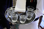 waiter with glasses cold water on his tray