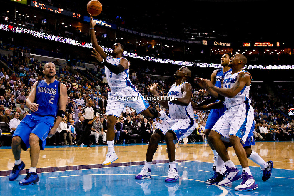 November 17, 2010; New Orleans, LA, USA; New Orleans Hornets point guard Chris Paul (3) drives and shoots during the second half against the Dallas Mavericks at the New Orleans Arena. The Hornets defeated the Mavericks 99-97. Mandatory Credit: Derick E. Hingle