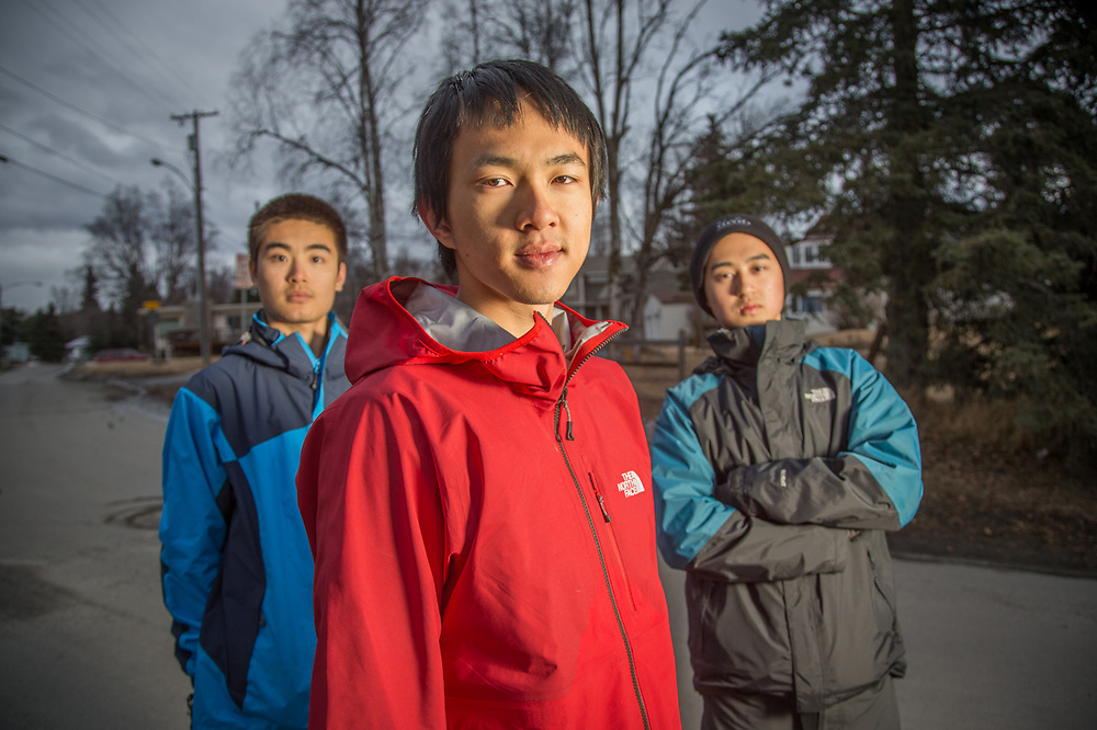 "Chinese college freshmen students Diwei Xiong, Shang Shangwen Su and Lucas Lu from southern Califonia explore Bootleggers Cove in Anchorage.  ""We decided to come to Alaska for spring break..we like to camp and hike."""