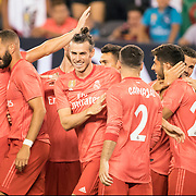 MEADOWLANDS, NEW JERSEY- August 7:   Marco Asensio #20 of Real Madrid is congratulated by team mates after scoring his sides first goal during the Real Madrid vs AS Roma International Champions Cup match at MetLife Stadium on August 7, 2018 in Meadowlands, New Jersey. (Photo by Tim Clayton/Corbis via Getty Images)