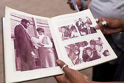 Michael Cowden shows a photo of Ali and him taken back in 1967 when Ali came to visit his alma mater Central High School at the Muhammad Ali Center, Sunday, June 05, 2016.<br /> <br /> Legendary heavyweight boxing champion Muhammad Ali, a Louisville, Ky. native, died Friday, June 3, 2016. Murals and tributes could be seen across his hometown as people mourned the charismatic sports figure.