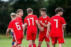 WREXHAM, WALES - Tuesday, August 13, 2019: Wales' Jonathan Bland and Ethan Hartness congrats; ate the scorer of the second goal Alex Roberts during the UEFA Under-15's Development Tournament match between Wales and Cyprus at Colliers Park. (Pic by Paul Greenwood/Propaganda)