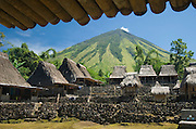 Village and volcano view from beneath bamboo roof