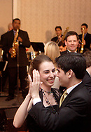 Sammy Paris (left) and Son del Caribe play as Christina Cook (left,) from Brookville dances with Enrique Rivera-Cerezo, a U.D. Student from San Juan at the 17th Artemis Center Gala, Saturday night.