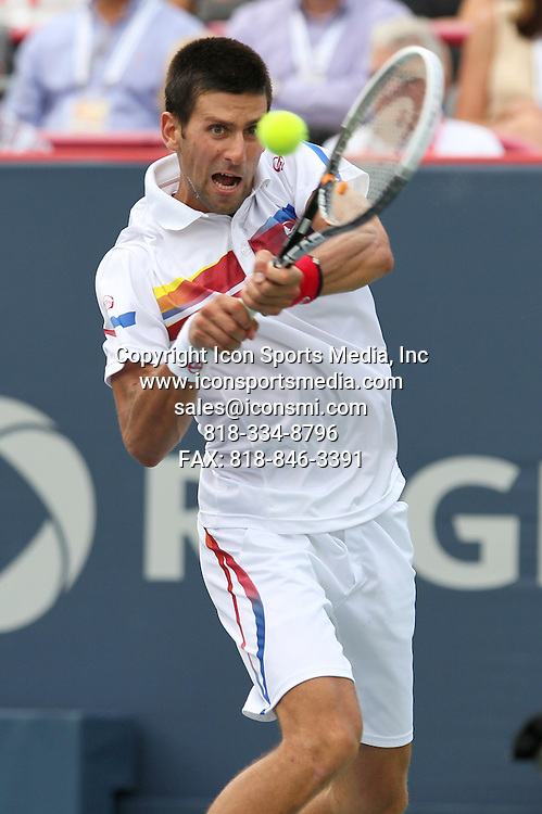 14 AUG 2011: Novak Djokovic (SRB) in action against Mardy Fish (USA) during the ATP World Tour Masters - Rogers Cup Finals at the Stade Uniprix, in Montreal, Quebec, Canada. Djokovic defeated Fish in 3 sets of 6-2, 3-6 and 6-4.