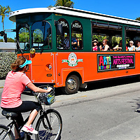 Old Town Trolley Tours Bus in Key West, Florida<br /> Key West is small – only one mile wide and four miles long – and most Old Town attractions are within a compact area. So it is best explored and enjoyed on foot.  Other options include guided tours, a hop-on hop off bus such as the Old Town Trolley Tours or renting a bike. There are also plenty of cabs to get you back to your hotel when your shoes begin to pinch.