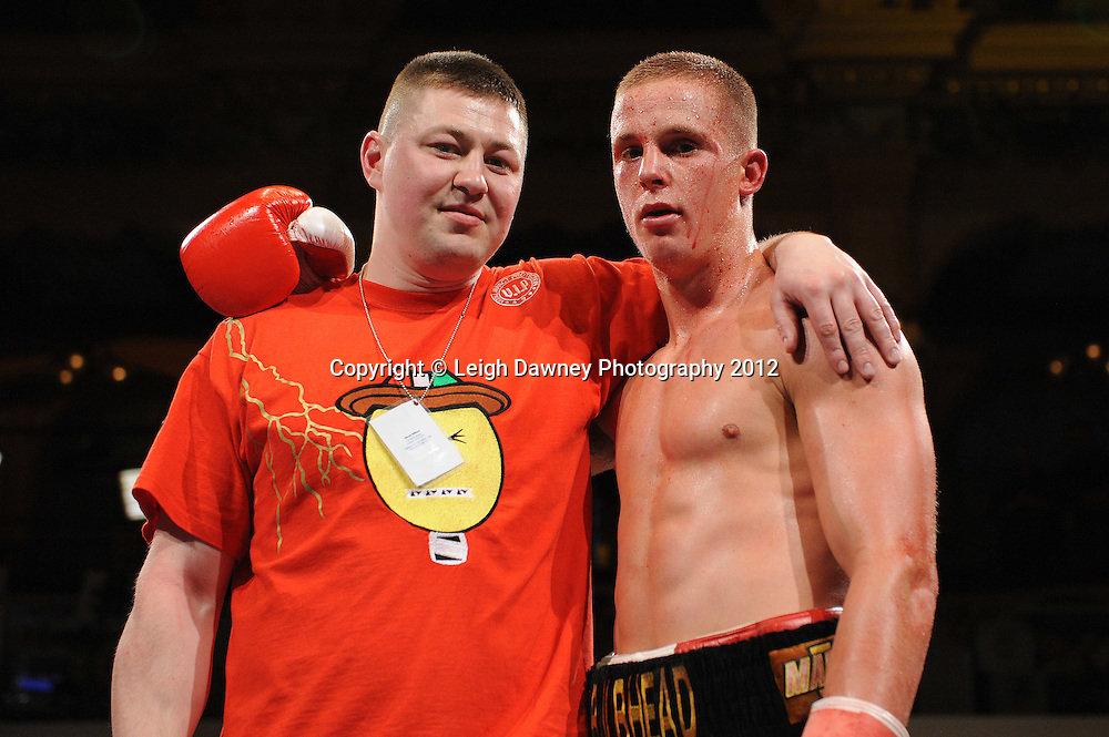Karl Place pictured with Trainer defeats Dan Blackwell in a Light Welterweight contest at The Winter Gardens, Blackpool on the 31st March 2012. Frank Maloney and Steve Wood VIP Promotions. © Leigh Dawney Photography 2012.