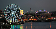 The Seattle Great Wheel glows in the early evening, along with CenturyLink Field.<br /> Greg Gilbert / The Seattle Times