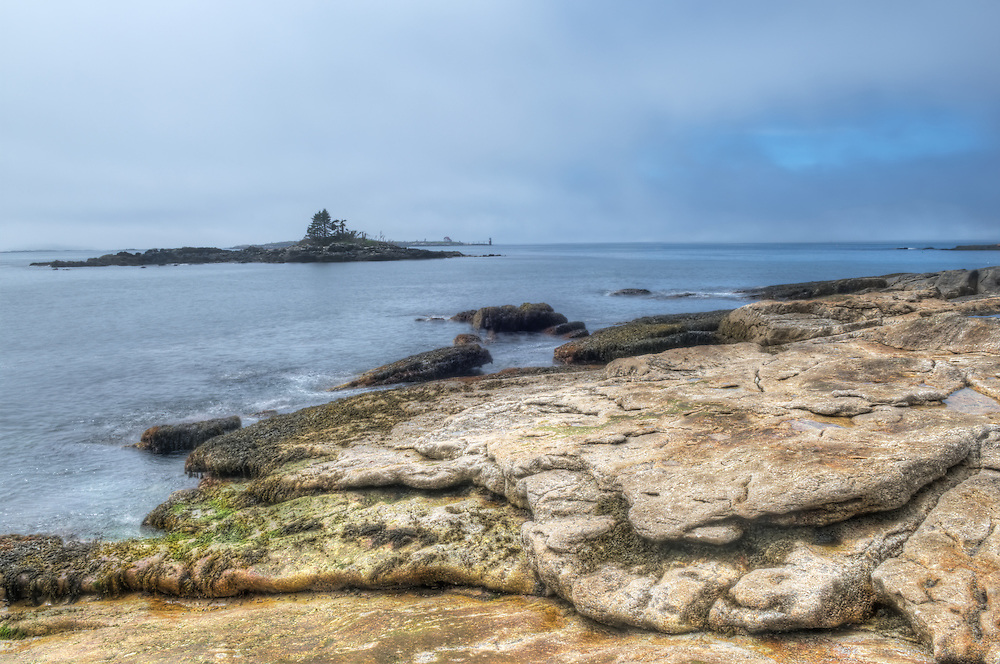 A fog bank rolls in at Ocean Point near Boothbay Harbor, Maine.