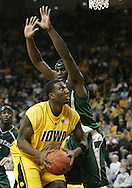 04 JANUARY 2007: Iowa forward Cyrus Tate (44) looks up at the basket while being guarded by Michigan State forward Marquise Gray (41)in Iowa's 62-60 win over Michigan State at Carver-Hawkeye Arena in Iowa City, Iowa on January 4, 2007.