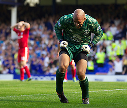 LIVERPOOL, ENGLAND - Saturday, October 1, 2011: Everton's goalkeeper Tim Howard celebrates after saving a penalty kick during the Premiership match against Liverpool at Goodison Park. (Pic by Vegard Grott/Propaganda)