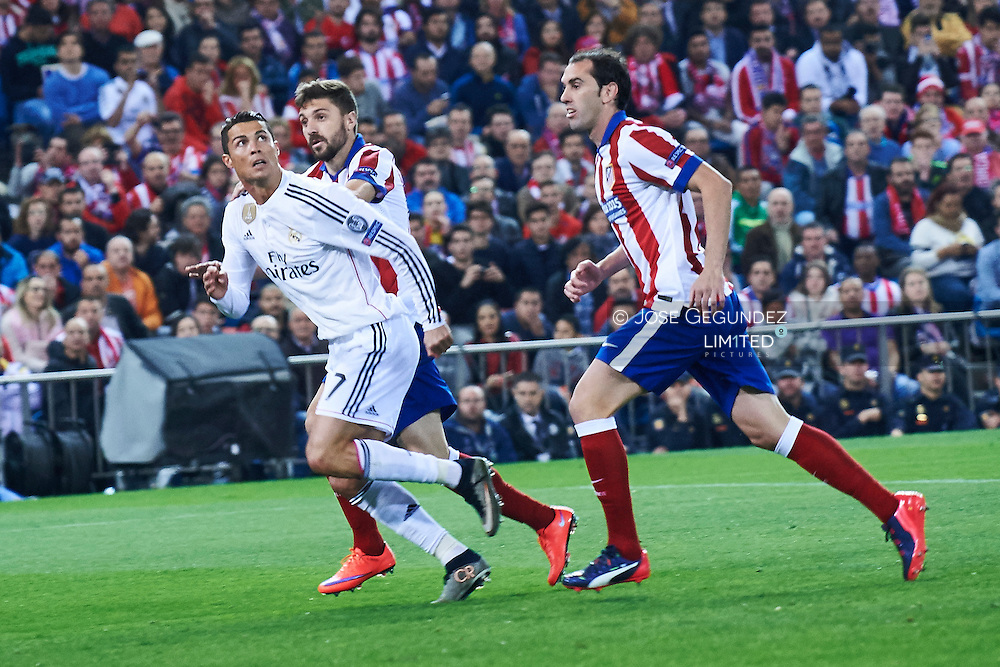 Cristiano Ronaldo (Real Madrid F.C.) and Godin in action during the Champions League, round of 4 match between Atletico de Madrid and Real Madrid at Estadio Vicente Calderon on April 14, 2015 in Madrid, Spain