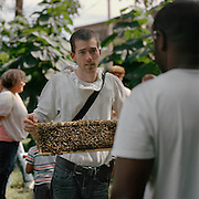 Trevor moves around the spectators of a bee domnstration at the Urban County Fair in North Philadelphia. Photo by Lori Waselchuk. 2014.