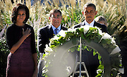 President of the United States Barack Obama, First Lady Michelle Obama and Secretary of Defense Leon E. Panetta observe a moment of silence at a wreath during a 9/11 remembrance ceremony held at the Pentagon Memorial, Sept. 11, 2012. (DoD Photo By Glenn Fawcett) (Released)