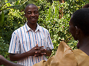 Yayeri Nanyong (right) talking to a Send a Cow extension worker. She hopes for life to improve. It was starting to improve with the help of Send a Cow but then her cow died and things became tough again. She keeps going though with what she has and unlike many people her age and in her situation she still sends the children to school.