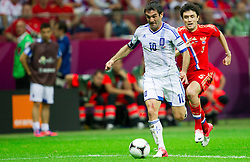 Giorgos Karagounis  of Greece vs Yuri Zhirkov of Russia in action when Giorgos Karagounis  of Greece scores during the UEFA EURO 2012 group A match between  Greece and Russia at The National Stadium on June 16, 2012 in Warsaw, Poland.  (Photo by Vid Ponikvar / Sportida.com)