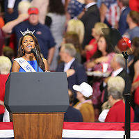 Miss Mississippi Asya Branch of Tupelo performs the American anthem before Tuesday Republican rally in Southaven with President Donald Trump.