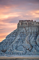 Sunset over Factory Butte in the badlands of Southern Utah in Spring.