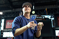 PHOENIX, AZ - JUNE 09:  Brett Phillips #33 of the Milwaukee Brewers smiles while signing a baseball for a fan prior to the MLB game against the Arizona Diamondbacks at Chase Field on June 9, 2017 in Phoenix, Arizona. The Milwaukee Brewers won 8-6.  (Photo by Jennifer Stewart/Getty Images)