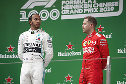 April 14, 2019 - Shanghai, China - Motorsports: FIA Formula One World Championship 2019, Grand Prix of China, ..#44 Lewis Hamilton (GBR, Mercedes AMG Petronas Motorsport), #5 Sebastian Vettel (GER, Scuderia Ferrari Mission Winnow) (Credit Image: © Hoch Zwei via ZUMA Wire)