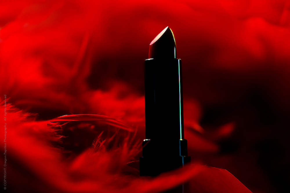 full colour image of red lipstick against a background of red feathers especially created for the MS Australia campaign to Kiss Goodbye to MS in 2013
