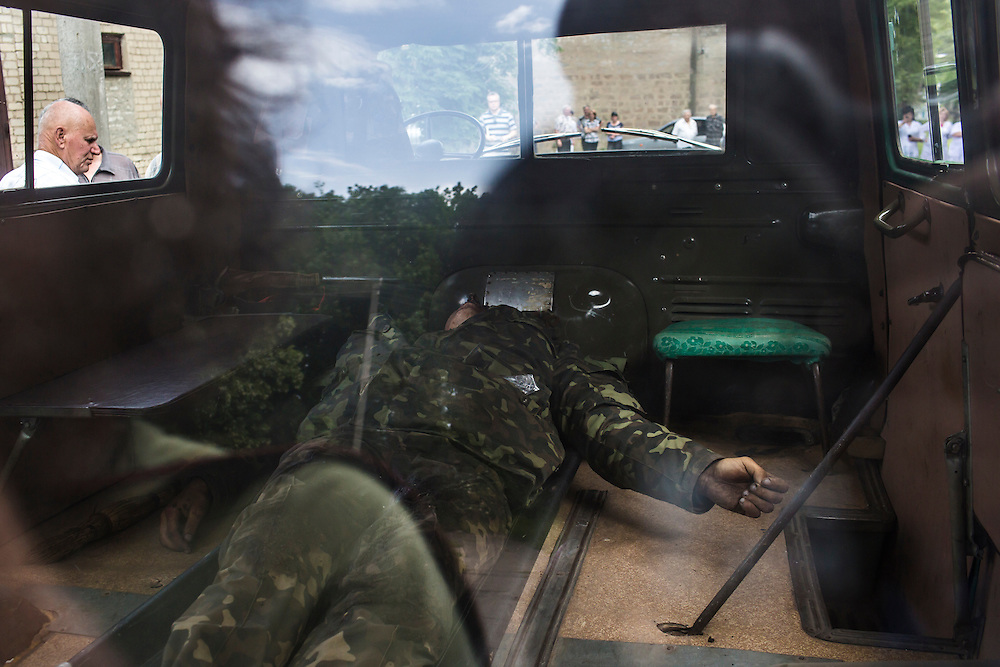 VOLNOVAKHA, UKRAINE - MAY 22:  The body of a Ukrainian soldier killed during an attack on a military checkpoint earlier in the day by unknown forces is transported to the morgue on May 22, 2014 in Volnovakha, Ukraine. Authorities reported fifteen soldiers were killed and 31 injured. (Photo by Brendan Hoffman/Getty Images) *** Local Caption ***