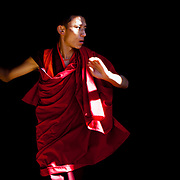 A monk training dances for spiritual festivals in Trongsa Dzong, Trongsa, Bhutan, Asia
