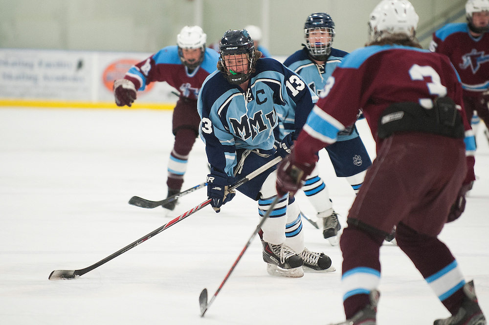 MMU's Jackson Wright (13) looks to take a shot during the boys hockey game between North Country and Mount Mansfield at the Essex Skating Facility on Wednesday night January 6, 2016 in Essex. (BRIAN JENKINS/for the FREE PRESS)