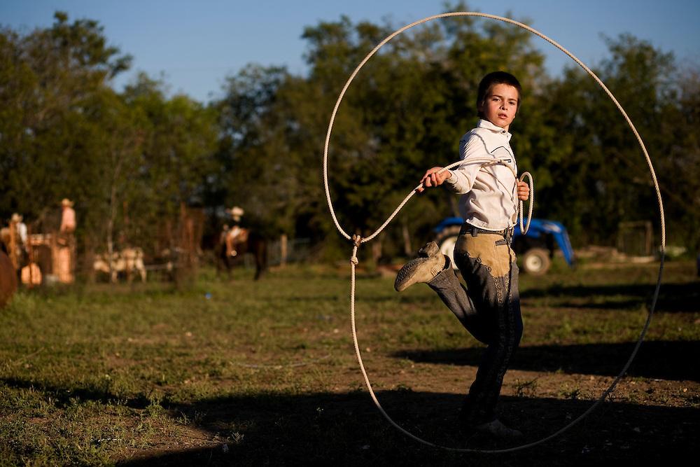 Julia Robinson photo.A young charro shows off his skill with a reata at El Bajio in Von Ormy, Texas.