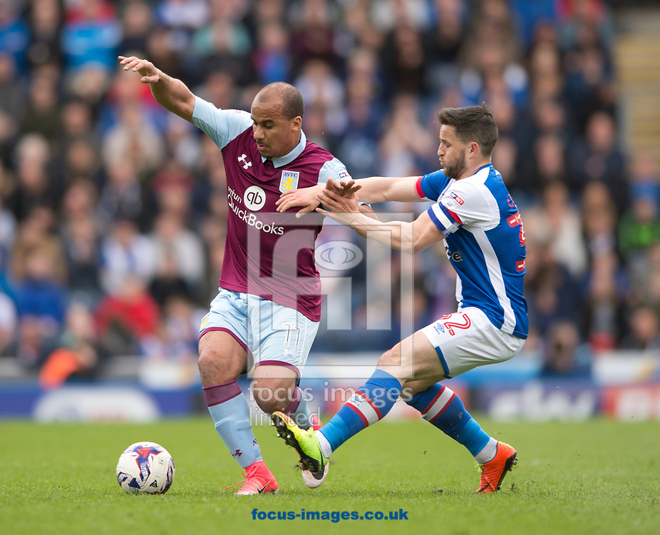 Gabriel Agbonlahor of Aston Villa (left) holds off Craig Conway of Blackburn Rovers during the Sky Bet Championship match at Ewood Park, Blackburn<br /> Picture by Russell Hart/Focus Images Ltd 07791 688 420<br /> 29/04/2017