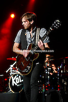 Kings of Leon performing at Madison Square Garden on January 29, 2009. ..Caleb Followill -  beard, wearing a grey t-shirt and black vest. (lead singer/rhythm guitar..