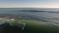 Aerial view of (SUP) standup paddle board surfing at Palliser Bay, Wairarapa, New Zealand